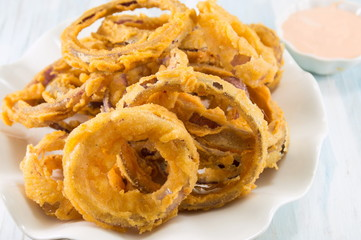 beer battered onion rings close up