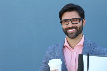 Brunette handsome young businessman smiling with copy space