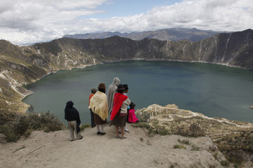 Native people and tourists visit the Laguna de Quilotoa crater lake near Latacunga, Ecuador, South America