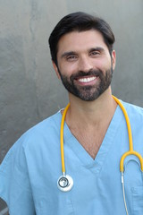 Young handsome bearded doctor smiling
