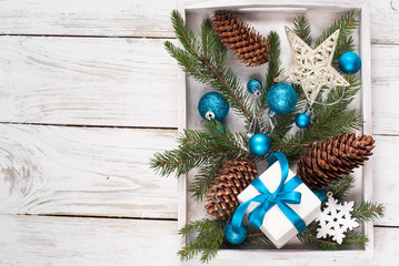 Christmas background. Blue decorations gift cones at white box.