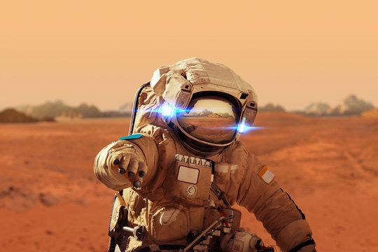 Spaceman walks on the red planet Mars. Space Mission. Astronaut