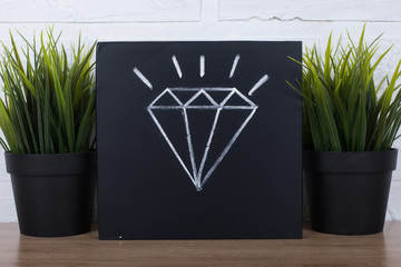 diamond write on chalkboard background