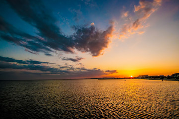 Amazing view of clear sea landscape with cloudy sky as a background Sunset time. Baku, Azerbaijan