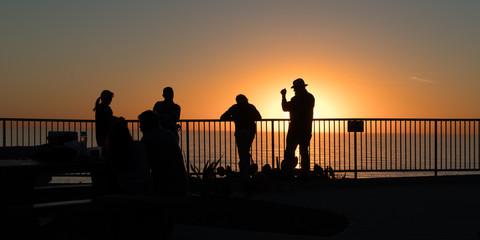 Folks chatting at sunset