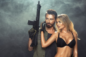 An attractive young couple with guns
