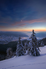 Evening in winter mountains