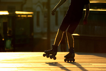 silhouette pairs of legs on roller skates
