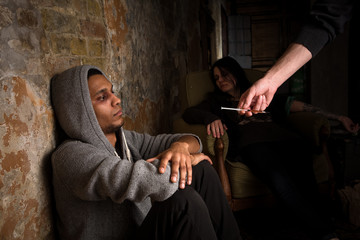 Drug dealer's hand - image of Mafia offering young people to take drugs. Drugs concept. Disease concept.