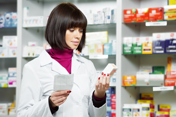 pharmacceutist woman worker in drug store