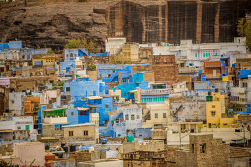 Mehrangarh Fort towering over the blue rooftops in Jodhpur, the Blue City, Rajasthan, India, Asia