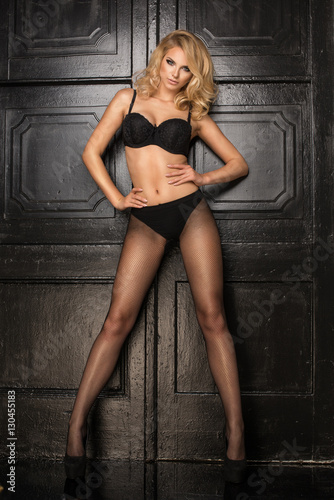 939e1e31a Young sexy blonde woman in dark lingerie and tight