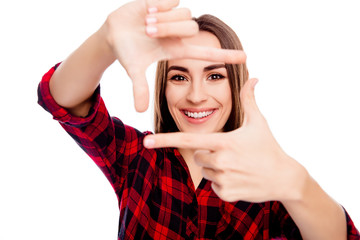 Happy smiling young woman making frame with fingers
