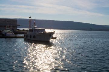 Sea dock, yacht in berth on sunset