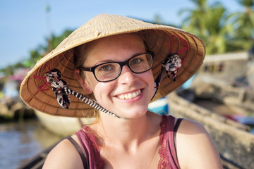 Young Caucasian tourist wearing Vietnamese conical hat, Phong Dien floating market, Can Tho, Mekong Delta, Vietnam, Indochina, Southeast Asia, Asia