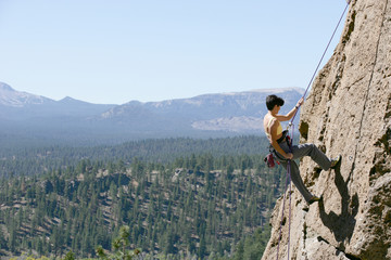 Female Climber Rappelling