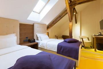 Hotel bedroom interior in the attic