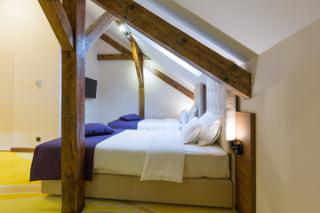 Interior of a luxury hotel bedroom in the attic