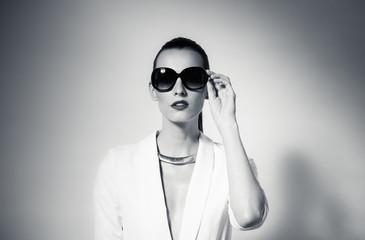 Fashion portrait of woman wearing sunglasses.
