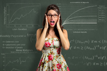 Woman investor overwhelmed by investment economy financial report math panic and stress