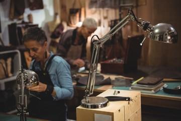 Attentive craftswoman working