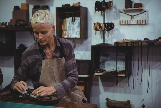 Craftswoman working on a piece of leather