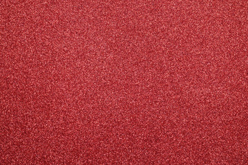 Focused red texture glitter background