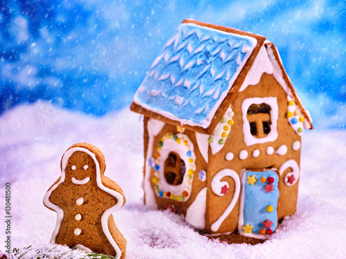 Christmas Gingerbread House Background.Christmas Gingerbread House Cookie In Sugar Snow Next To