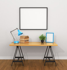 White blank poster on the grey wall near the Desk with a lamp, b