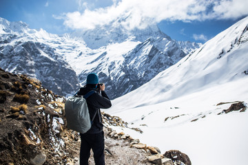 photographer taking picture of Himalayan mountain peak, peak of Machapuchare or Fishtail peak in Nepal, Napal...
