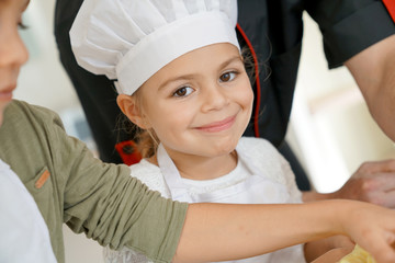 Portrait of 6-year-old girl in pastry class