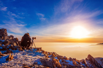 Professional photographer takes photos with camera on tripod on Deogyusan mountain.