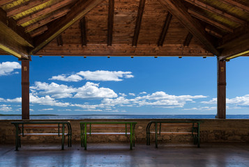 Patio with benches, ocean view and sky. Peaceful perspective, Skopje Macedonia.