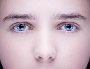 Close up image of insightful look blue human eyes