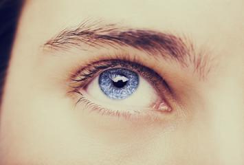 Close up image of insightful look blue human eye