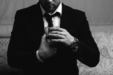 businessman is drinking a glass of whiskey