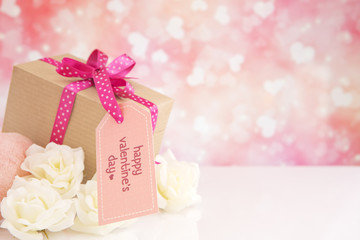 Valentine's gift and roses with a bright glittering background