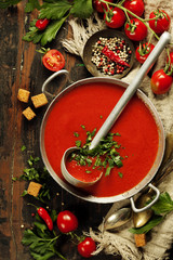 Homemade Tomato soup on wooden table