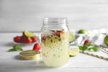 Fruit lemonade in mason jar on wooden table