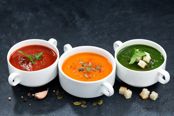 assortment of vegetable cream soup on a dark background