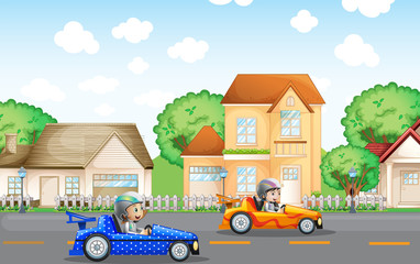 Two kids in racing car driving in neighborhood