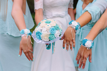 turquoise wedding bracelets and the hands of friends, the bride with turquoise bouquet