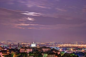View at Old Town Citta Alta of Bergamo from San Vigilio Hill. Bergamo, Italy. Night view.