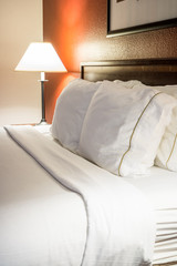 Hotel Room Bed Pillows and Lamp
