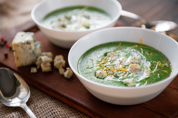 fresh and tasty green cream soup of spinach and broccoli