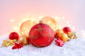 Christmas decorations on snow and Christmas lights. Festive Christmas background
