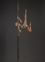 Fototapeta Little girl on pylon studio shot obraz