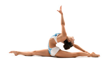 Young female gymnast doing side splits in profile