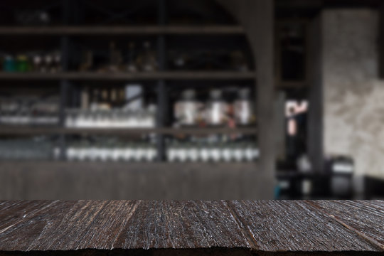 glass on counter bar in restaurant interior blur background with