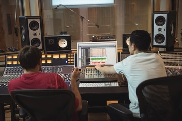 Audio engineers using sound mixer